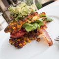 sweetcorn fritters, roast tomato,spinach, bacon and avocado